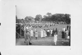 Photograph of a performance on a field during a Dalhousie reunion