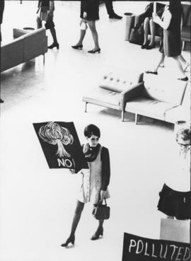 Photograph of a Mount Saint Vincent student at the Halifax airport protesting the landing of a Un...