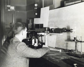 Photograph of man using laboratory equipment in the Science Building