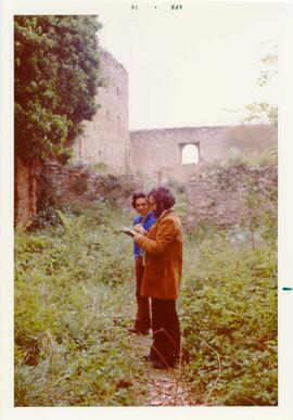 Photograph of two men in Castello dell Abate by P. Dohrn