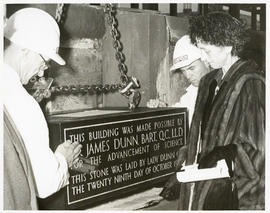 Photograph of Lady Dunn laying the Sir James Dunn Science Building cornerstone