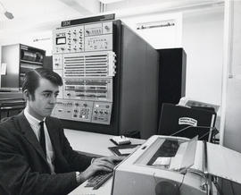Photograph of an unidentified man working on a computer at the Dalhousie Computer Centre