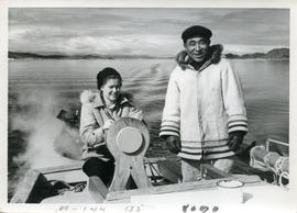 Photograph of Barbara Hinds steering a boat with Pitsolak