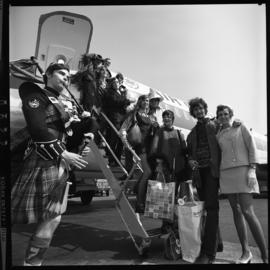 Photograph of the Privateers musical group returning from Osaka, Japan