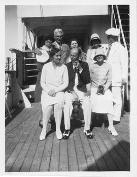Photograph of Arthur Stanley MacKenzie and other unidentified people on a cruise ship