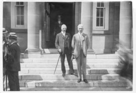 Photograph of G. S. Campbell and A. S. MacKenzie on the front steps of the Macdonald Library