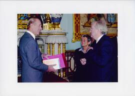"Photograph of Elisabeth Mann Borgese's presentation of ""Oceanic Circle"" to Prince Philip at Bucki..."