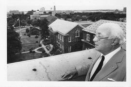 Photograph of Henry Hicks standing on the roof of the Henry Hicks Academic Administration Building