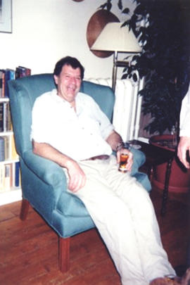 Photograph of Bill Owen seated in armchair at his farewell party