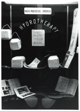 Photograph of display case exhibit on Health Professions Libraries and Hydrotherapy
