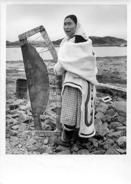 Photograph of a woman named Lipitia with a stretched seal skin