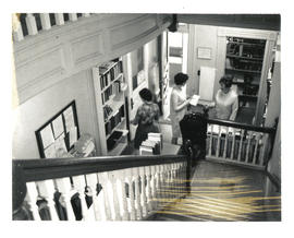 Photograph of library staff and patron in Medical-Dental Library - 5963 College Street