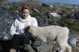 Photograph of Barbara Hinds and a dog in Frobisher Bay, Northwest Territories