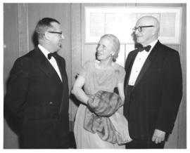 Photograph of three people at a miscellaneous unknown health-related event