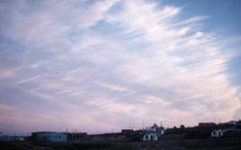 Photograph of the sky above a group of houses in Frobisher Bay, Northwest Territories