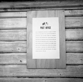 Photograph of a sign at a post office in Dawson City, Yukon