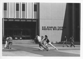 Photograph of a game in front of the Tupper Medical Building