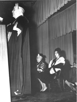 Photograph of Lady Dunn and others on stage at the opening ceremony of the Sir James Dunn Building
