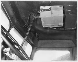 Photograph of a DT65 mobile radio unit mounted in the cab of a snow plow in Prince Edward Island