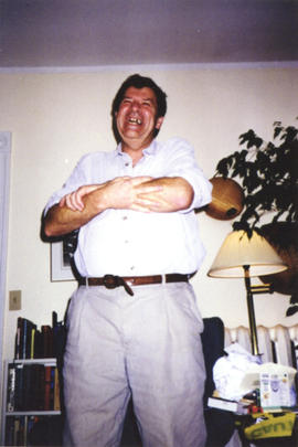Photograph of Bill Owen standing at his farewell party