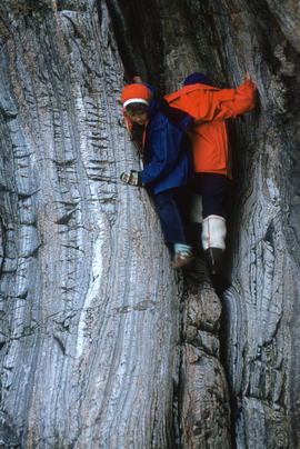 Photograph of two people rock climbing in Cape Dorset, Northwest Territories
