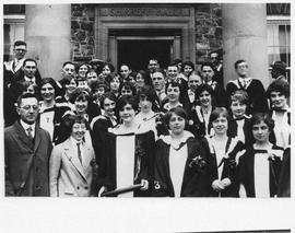 Photograph of graduates standing in front of Shirreff Hall