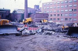 Photograph of demolition of Medical-Dental Library, removing rubble
