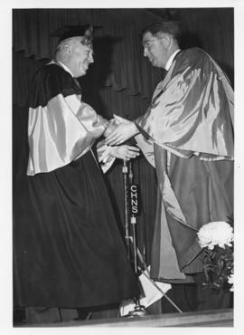 Photograph of Henry Hicks conferring an honorary degree on Dr. Beveridge