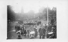 Postcard with a photograph of an alumni procession on the Grand Parade