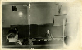 Photograph of George A. Burbidge in a medical sciences classroom