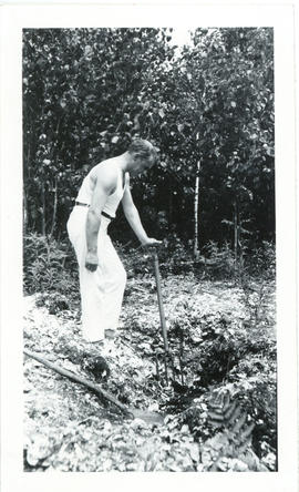 Photograph of Thomas Head Raddall digging in a shell midden at Port Joli, Nova Scotia