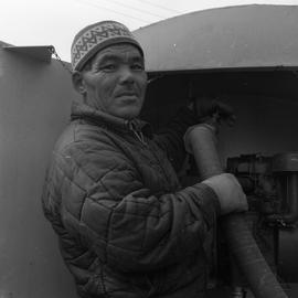Photograph of a man with a water truck in northern Quebec