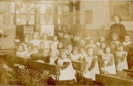 Portrait of the children and teacher of Class III printed on a postcard