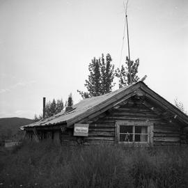 Photograph of a log cabin post office in the Yukon
