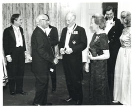 Photograph of Thomas Head Raddall chatting with Governor General Roland Michener and his wife, No...