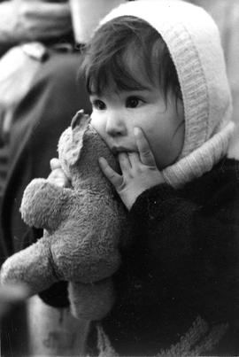 Photograph of an unidentified girl holding a teddy bear