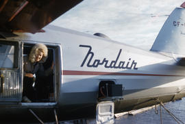 Photograph of Barbara Hinds on an airplane in Fort Chimo, Quebec