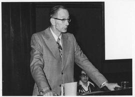 Photograph of an unidentified person speaking at a Canadian Postal Service meeting