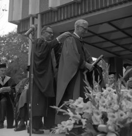 Photograph of Dr. C. J. W. Beckwith receiving an honorary degree