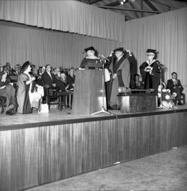 Photograph of an unidentified person receiving an honorary degree