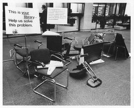 Photograph of broken chairs and other equipment