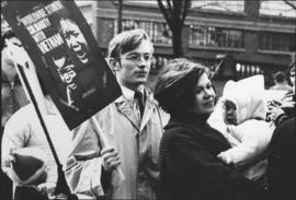 Photograph of Dalhousie sociology student, Chris Thurrott, with his wife and child, at an anti-Vi...