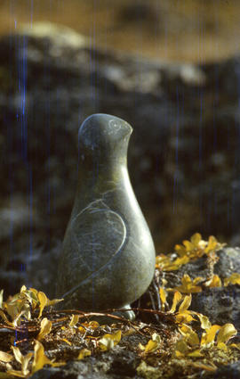 Photograph of a stone sculpture of a ptarmigan
