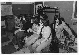 Photograph of high school students watching a slide presentation