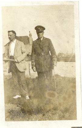 Photograph of T.H. Raddall, Sr. in uniform while on leave in England standing with a gentleman in...