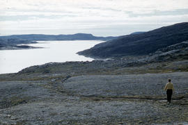 Photograph of Barbara Hinds walking at Tellik Inlet, Northwest Territories