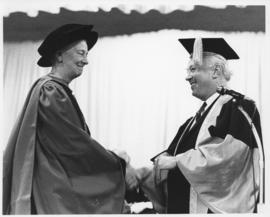 Photograph of Henry Hicks presenting a degree
