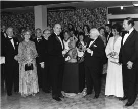 Photograph of Henry Hicks and guests at a reception