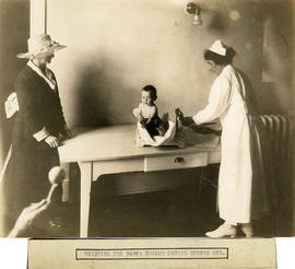 Photograph of Massachusetts-Halifax Health Commission nurse weighing a baby