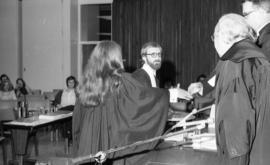 Photograph of two law students being presented with awards